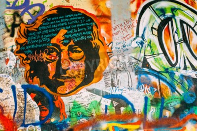 Wall mural Prague, Czech Republic - October 10, 2014: Famous place in Prague - The John Lennon Wall. Wall is filled with John Lennon inspired graffiti and lyrics from Beatles songs