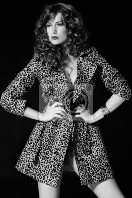 Pretty red-haired girl with curls, pantera coat black and white
