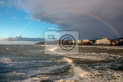 Rainbow over the Baltic Sea after a winter downpour