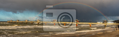 Rainbow over the Baltic Sea after a winter downpour,panorama.