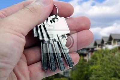 real estate agent hands over the keys.