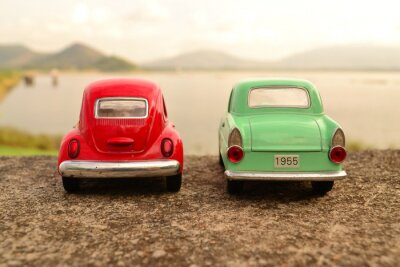 Wall mural Red and green toy car park couple on the road