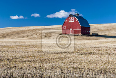 Wall mural Red barn blue sky and wheat stuble field