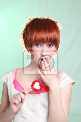 red head girl with red lollipop with heart