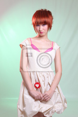 red head girl with red lollipop with heart in white dress