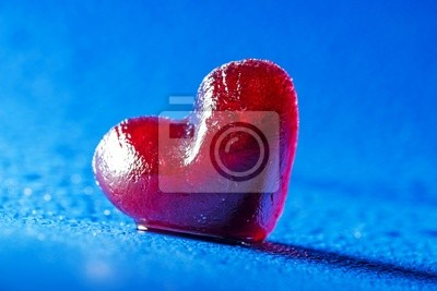 red heart of ice on a blue  background