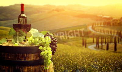 Wall mural Red wine with barrel on vineyard in green Tuscany, Italy