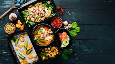 Wall mural restaurant dish delivery. Catering, dinner dishes in boxes. Top view. Free space for your text. Rustic style.
