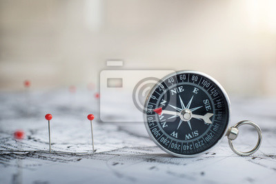 Retro compass on ancient map background. Travel geography navigation concept background.
