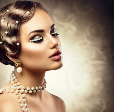 Wall mural Retro styled makeup with pearls. Beautiful Young woman portrait