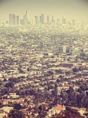 Wall mural Retro stylized aerial view of Los Angeles seen through smog, USA