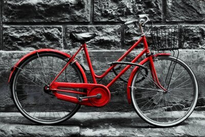 Wall mural Retro vintage red bike on black and white wall.
