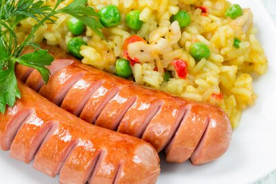 Rice with vegetables and two sausages