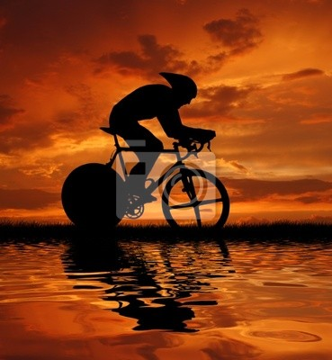 Road biker silhouette in sunrise