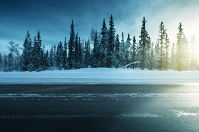 road in winter forest, sunset time