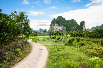Road leading to limestone mountain in china