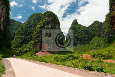 Road through karst limestone mountains in asia