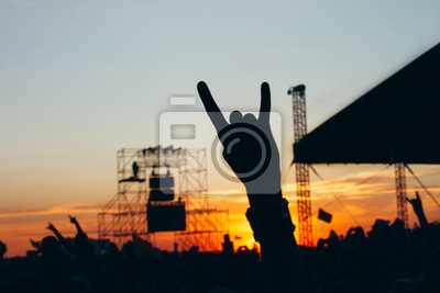 Wall mural Rock concert, silhouettes of happy people raising up hands