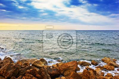 rocky beach at sunset, Haifa, Israel