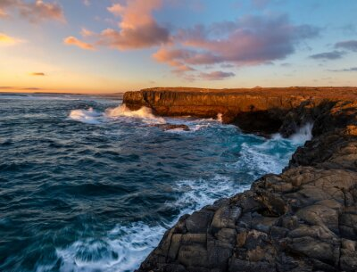 rocky cliff in Fuerteventura during a storm at sunset