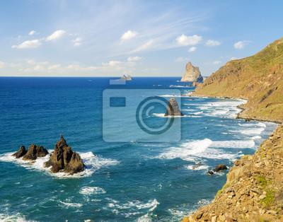 Rocky coast of the Atlantic Ocean in Tenerife, rocky, volcanic beach