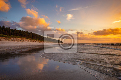 Romantic, colorful sunset over the sea beach, baltic sea, Poland