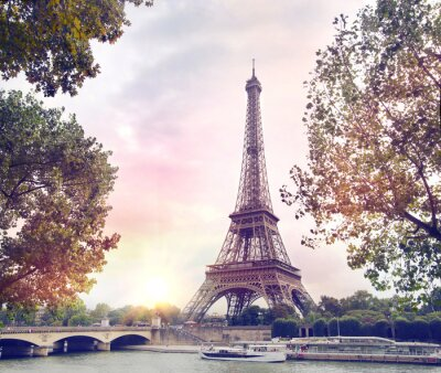 Wall mural Romantic sunset background. Eiffel Tower with boats on Seine river in Paris, France.