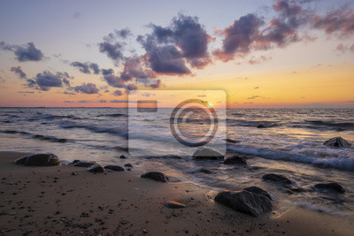 Romantic sunset over the sea beach, baltic sea, Poland