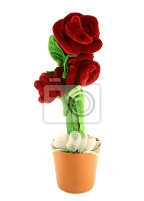 Rose made from wool fabric on white background