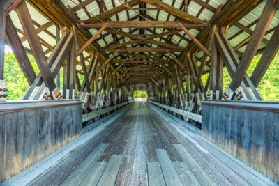 Wall mural Rowell Covered Bridge is a covered bridge in Hopkinton, New Hampshire which carries Rowell Bridge Road over the Contoocook River. It is a long truss style bridge.