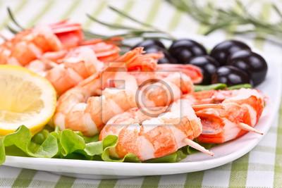 royal shrimps on wooden skewers