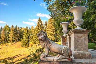 Ruin of  ancient marble sculpture of  lion in  summer park