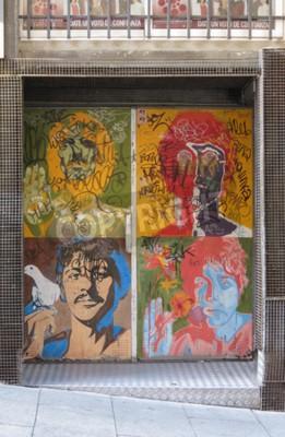 Wall mural SALAMANCA, SPAIN - CIRCA JUNE 2015: The Beatles pop art portraits by Richard Avedon (1967), reproduced on a night club door, with graffiti