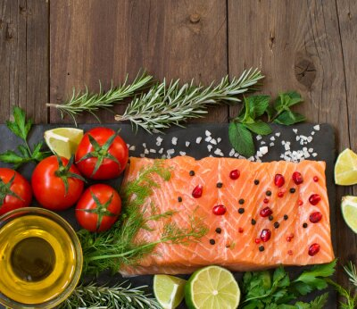 Wall mural Salmon with vegetables, olive oil and herbs