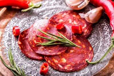 Wall mural Sausage Chorizo. Spanish traditional chorizo sausage, with fresh herbs, garlic, pepper and chili peppers. Traditional cuisine.
