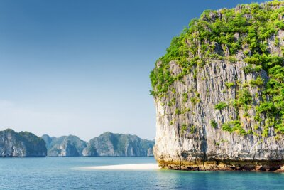 Wall mural Scenic karst tower-isle and white wild beach in the Ha Long Bay