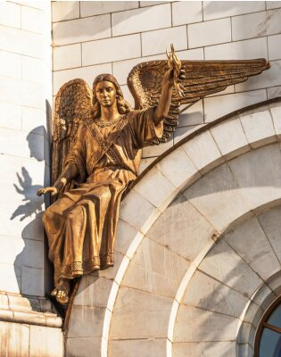 Sculpture of  Archangel Uriel with fire in hand on  temple wall