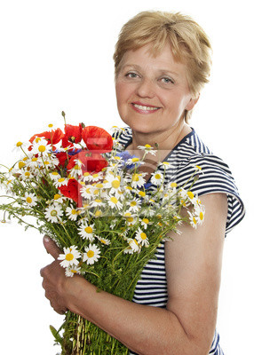 senior woman smiling with bunch of wild flowers