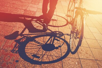 Wall mural Shadow on Pavement, Man Pushing Bicycle