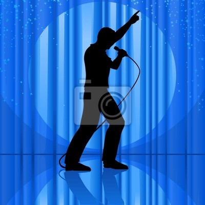 silhouette singing to a microphone on theatrical stage