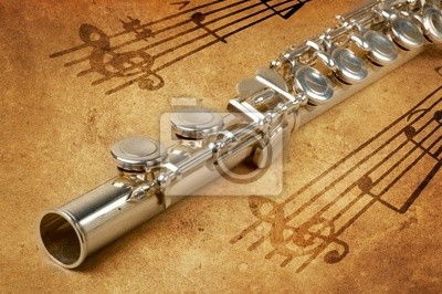 Wall mural Silver flute on an ancient musical background
