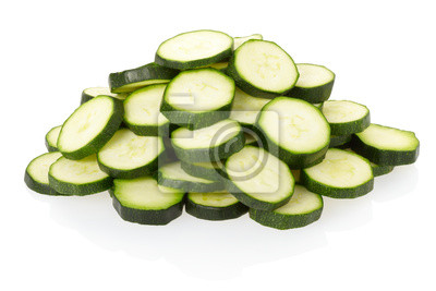 Wall mural Sliced courgette or zucchini on white with clipping path