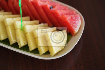 slices of pineapple and watermelon on a table