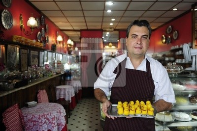 small business: owner of a cafe showing  tasty pastry