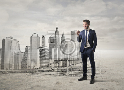 Smiling businessman projecting the skyline