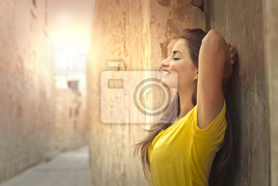 Smiling woman with yellow t-shirt