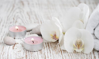 Wall mural Spa set with white orchids