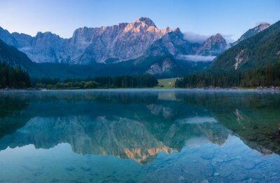 Spectacular, beautiful sunrise over the alpine Lake Laghi di Fusine in the Julian Alps in Italy