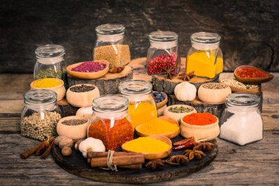 Wall mural Spices and herbs on the wooden table