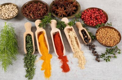 Wall mural Spices in wooden spoon.
